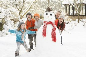 family-playing-in-snow_iStock-133352805-300x200.jpg